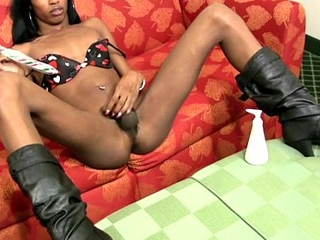 Black t-girl inserts xmas toy deep inner her butt hole