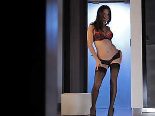 Selma Sins struts her stuff in sheer stockings and conceited heels before filling her horny hole with her talented fingers