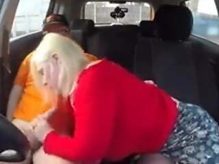Mature here a blowjob alongside car thither young boy