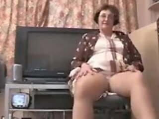 British granny strips naked for you