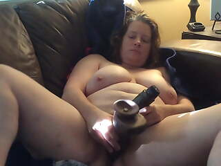 BBW mom with muted pussy on the couch with black dildos