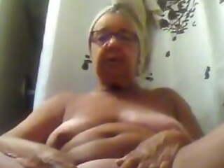 Granny masturbates while talking dirty