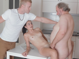 Chap-fallen brunette Lora and her man are in the kitchen together, and he talks to her about inviting over his doyen band together over to have sex with her.