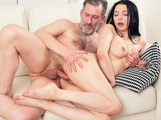 Experienced but still strong man thrusts his dick deep into a fresh throat increased by pussy of his younger brunette sham one's age from behind.