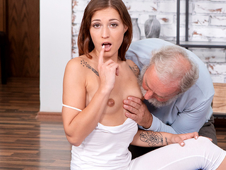 Curious old man watches a sexy brunette performing stretching exercises up a niggardly outfit