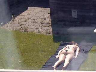 Sunbathing (Partly Topless)
