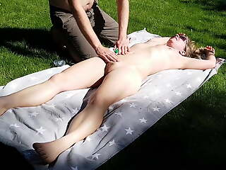 Rubbed with sun lotion and fucked in public