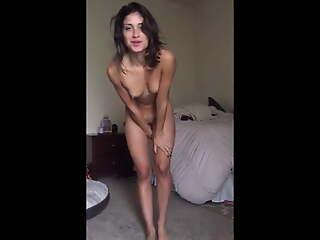 Watching a skinny milf masturbate standing up