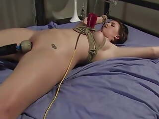 Orgasm with a fucking machine while tied
