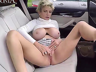 Busty Lady Sonia masturbates in someone's skin backseat of her automobile