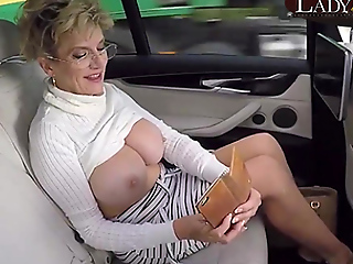 Mature Lady Sonia exposes her big tits down the car