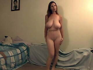 Sexy GILF with saggy boobs in pantyhose
